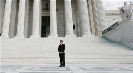 Chief Justice of the United States Supreme Court John Roberts is pictured on the front plaza of the Supreme Court in Washington in this October 1, 2010 file photograph. REUTERS/Larry Downing/Files