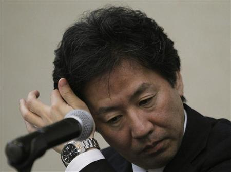 Japan's Finance Minister Jun Azumi scratches his head during a news conference after the 15th ASEAN plus 3 Finance Ministers and Central Bank Governors' meeting in Manila May 3, 2012. REUTERS/Romeo Ranoco