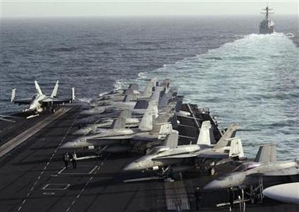 The Sterett Destroyer escorts the Nimitz-class aircraft carrier USS Abraham Lincoln (CVN 72) during a transit through the Strait of Hormuz, February 14, 2012. REUTERS/Jumana El Heloueh