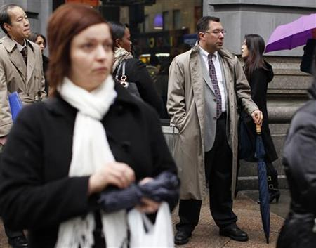 People wait in line to enter the NYCHires Job Fair in New York, December 9, 2009. REUTERS/Shannon Stapleton/Files