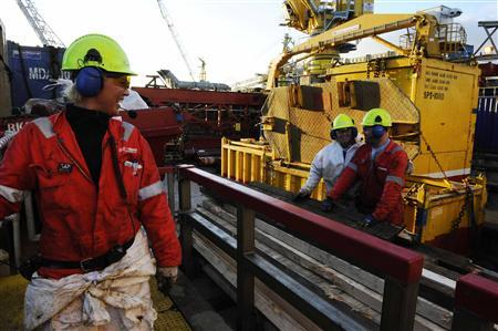 Oil workers are pictured as they work at the Oseberg oil field, in the North Sea, in this November 25, 2008 file photo. REUTERS/Marit Hommedal/NTB Scanpix/Files