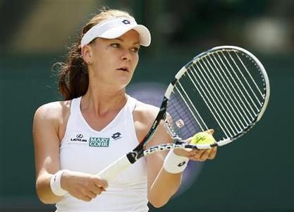 Agnieszka Radwanska of Poland prepares to serve to Angelique Kerber of Germany during their women's semi-final tennis match at the Wimbledon tennis championships in London July 5, 2012. REUTERS/Stefan Wermuth