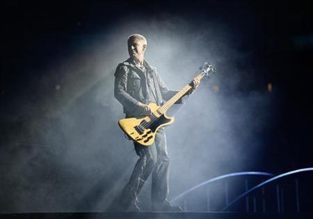 Bass guitarist Adam Clayton of the rock band U2 perform during the first of two concerts at Giants Stadium in East Rutherford, New Jersey, September 23, 2009. REUTERS/Gary Hershorn