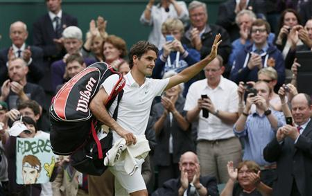 Roger Federer of Switzerland celebrates after defeating Novak Djokovic of Serbia in their men's semi-final tennis match at the Wimbledon tennis championships in London July 6, 2012. REUTERS/Stefan Wermuth