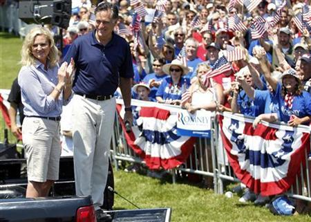 Republican presidential candidate and former Massachusetts Governor Mitt Romney smiles with his wife Ann (L) after addressing a crowd of supporters after taking part in the Wolfeboro Fourth of July Parade in Wolfeboro, New Hampshire July 4, 2012. REUTERS/Jessica Rinaldi