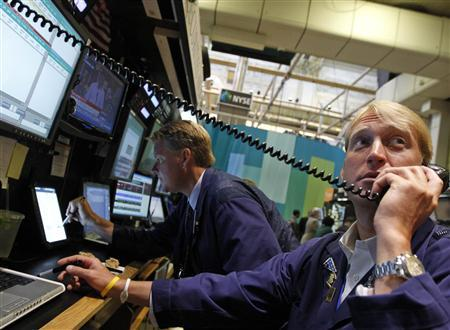 Traders John Bowers (L) and Scott Gueli work on the floor of the New York Stock Exchange, July 6, 2012. REUTERS/Brendan McDermid
