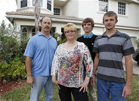 The Schramm family is seen in front of their home in Pembroke Pines, Florida February 7, 2012. (L-R): Robert, Martina, David and Nick Schramm. REUTERS/Joe Skipper