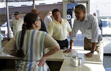 U.S. President Barack Obama (R) places his breakfast order during a visit to Ann's Restaurant in Akron, Ohio July 6, 2012. REUTERS/Kevin Lamarque