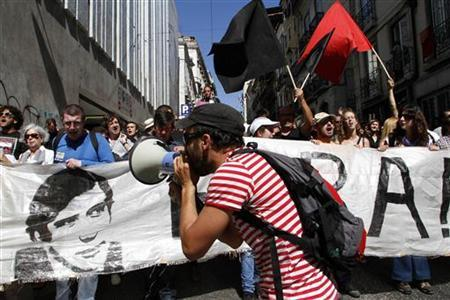 People shout slogans during a protest against unemployment in Lisbon June 30, 2012. REUTERS/Hugo Correia