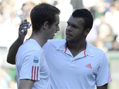 Andy Murray of Britain (L) is congratulated by Jo-Wilfried Tsonga of France after defeating him in their men's semi-final tennis match at the Wimbledon tennis championships in London July 6, 2012. REUTERS/Dylan Martinez