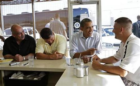 U.S. President Barack Obama (2nd R) talks to Keith Ross (R) as he sits down for breakfast at Ann's Place restaurant in Akron, Ohio July 6, 2012. REUTERS/Kevin Lamarque