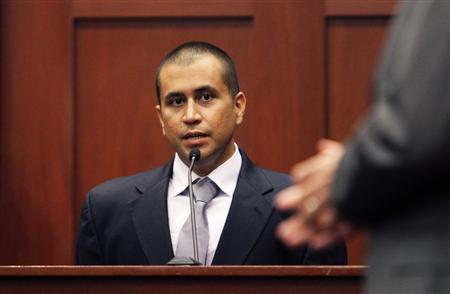 George Zimmerman, with lawyer Mark O'Mara testifies (R) from the stand at the Seminole County Courthouse for a bond hearing on second degree murder charges in the shooting death of Trayvon Martin in Sanford, Florida, in this April 20, 2012, file photo. REUTERS/Gary W. Green/POOL/Files