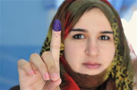 A woman shows her ink-stained finger after casting her vote in the National Congress election, in Benghazi July 7, 2012. REUTERS/Esam Al-Fetori