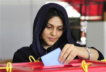 A woman casts her vote at a polling station during the National Assembly election in Benghazi July 7, 2012. Crowds of joyful Libyans, some with tears in their eyes, parted with the legacy of Muammar Gaddafi on Saturday as they voted in the first free national election in 60 years. REUTERS/Esam Al-Fetori