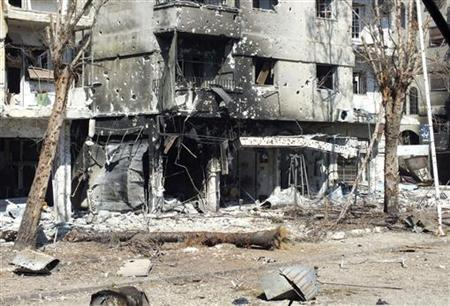 Buildings damaged during clashes between Syrian rebel fighters and government forces are seen in the Al Qusour neighbourhood of Homs July 5, 2012. REUTERS/Yazen Homsy