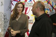 U.S. actress Angelina Jolie stands next to Mirsad Purivatra, director of the 18th Sarajevo Film Festival, before the festival July 7, 2012. REUTERS/Sarajevo Film Festival/Handout