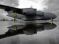 A U.S. airforce Globemaster3 C-17A is manoeuvred onto its stand ahead of the Farnborough Airshow 2012 in southern England July 7, 2012. REUTERS/Luke MacGregor