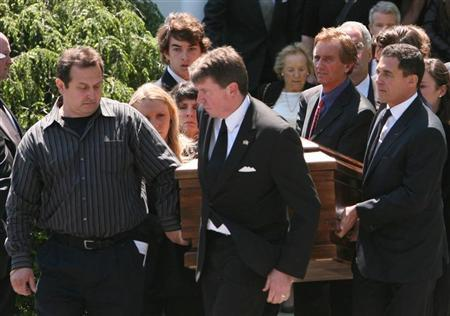 Mary Kennedy's casket is carried out of St. Patrick's Church by family, including her estranged husband Robert F. Kennedy Jr. (2nd R) after her funeral service concluded in Bedford May 19, 2012. Mary Kennedy, who died in an apparent suicide earlier this week, was recalled Saturday as an ''angel'' who was ultimately overwhelmed by a lengthy fight with depression. REUTERS/Michelle McLoughlin