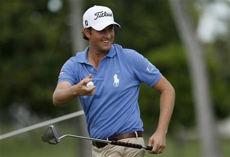 Webb Simpson of the U.S. smiles at the Waialae Country Club in Honolulu, Hawaii January 12, 2012. REUTERS/Hugh Gentry/Files