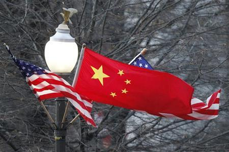 China's national flag is flanked by the U.S. flag along Pennsylvania Avenue near the U.S. Capitol in Washington on the occasion of Chinese President Hu Jintao's State visit, January 18, 2011. REUTERS/Hyungwon Kang