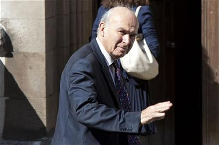 Britain's Business Secretary Vince Cable arrives to appear in front of the Leveson Inquiry into media practice at the Hight Court in London May 30, 2012. REUTERS/Neil Hall