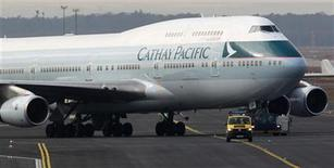 An airport apron controller vehicle is pictured in front of a Cathay Pacific Boeing B747-400 Aircraft on the runway at Frankfurt's airport February 21, 2012. REUTERS/Alex Domanski