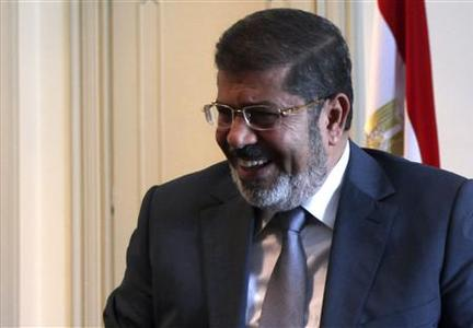 Egypt's first Islamist President Mohamed Mursi smiles during a meeting with U.S. Deputy Secretary of State William Burns at the presidential palace in Cairo July 8, 2012. REUTERS/Amr Abdallah Dalsh