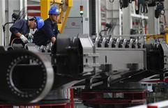 Employees work at a Sany assembly plant in Lingang Industrial Park, near Shanghai June 28, 2012. REUTERS/Carlos Barria
