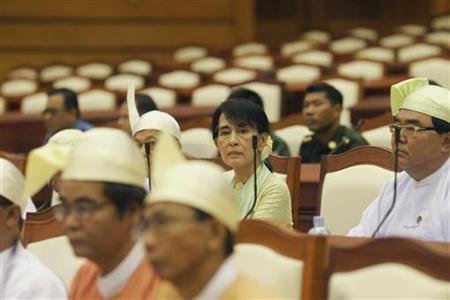 Myanmar pro-democracy leader Aung San Suu Kyi attends a parliamentary meeting at the Lower House of Parliament in Naypyitaw July 9, 2012. REUTERS/Soe Zeya Tun