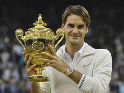 Roger Federer of Switzerland holds the winners trophy after defeating Andy Murray of Britain in their men's singles final tennis match at the Wimbledon Tennis Championships in London July 8, 2012. REUTERS/Toby Melville