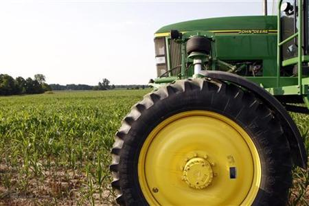 A John Deere sprayer sits in a popcorn field on the Matt Johnson family farm in Redkey, Indiana June 28, 2012. REUTERS/Brent Smith