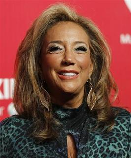 Songwriter Denise Rich poses at the 2012 MusiCares Person of the Year tribute honoring Paul McCartney in Los Angeles, in this February 10, 2012 file photo. REUTERS/Danny Moloshok/Files