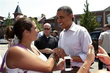 U.S. President Barack Obama greets residents of Beaver, Pennsylvania July 6, 2012. Obama is on a two-day campaign bus tour of Ohio and Pennsylvania. REUTERS/Kevin Lamarque