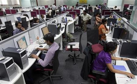 Workers are seen at their workstations on the floor of an outsourcing centre in Bangalore, February 29, 2012. Picture taken on February 29, 2012. REUTERS/Vivek Prakash/Files