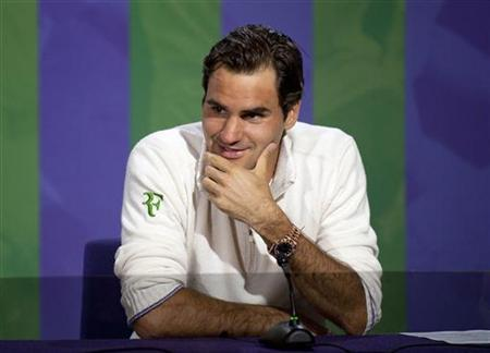 Roger Federer of Switzerland speaks at a news conference after defeating Andy Murray of Britain in their men's singles final tennis match at the Wimbledon Tennis Championships in London July 8, 2012. REUTERS/Neil Tingle/Pool