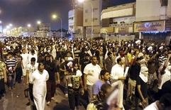 Protesters hold pictures of Sheikh Nimr al-Nimr during a rally at the coastal town of Qatif, against Sheikh Nimr's arrest July 8, 2012. REUTERS/Stringer