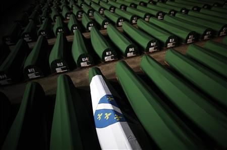 A coffin is covered with a war time Bosnian Muslim flag which was prepared for a mass burial at the Memorial Center in Potocari, near Srebrenica July 9, 2012. REUTERS/Dado Ruvic
