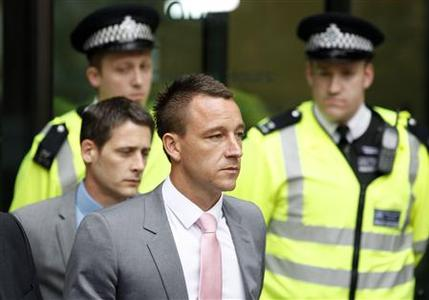 Chelsea and former England captain John Terry leaves Westminster magistrates court in central London, July 9, 2012. REUTERS/Andrew Winning