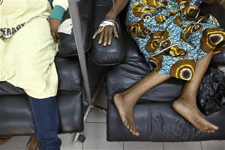 Cancer patients sit in a chemotherapy ward while receiving treatment at the Korle Bu Teaching Hospital in Accra, April 24, 2012. REUTERS/Olivier Asselin