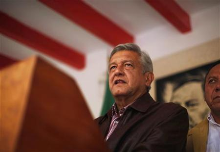 Andres Manuel Lopez Obrador, presidential candidate for the Party of the Democratic Revolution (PRD), attends a news conference at his campaign headquarters in Mexico City July 7, 2012. REUTERS/Tomas Bravo