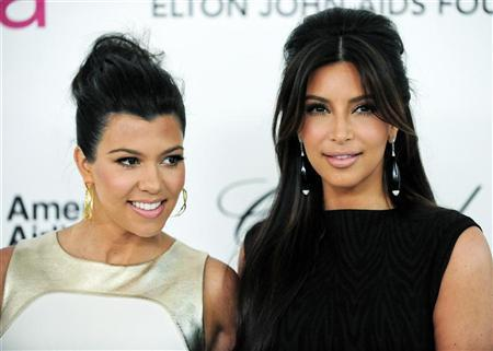 Television personalities sisters Kourtney and Kim Kardashian (R) arrive at the 20th annual Elton John AIDS Foundation Academy Awards Viewing Party in West Hollywood, California February 26, 2012. REUTERS/Gus Ruelas