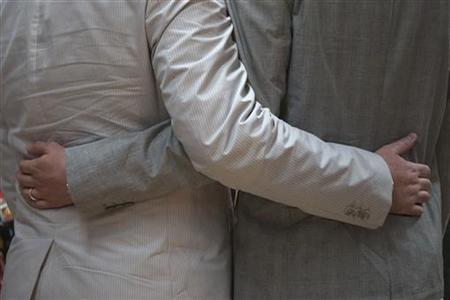 A same-sex couple hold each other before exchanging wedding vows in Manhattan, New York June 20, 2012. REUTERS/Adrees Latif/Files