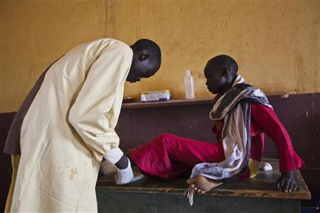 A girl is treated by a medic at the Aweil State Hospital in Aweil, the only hospital in the South Sudanese state of Northern Bahr el Ghazal, June 2, 2012. REUTERS/Adriane Ohanesian