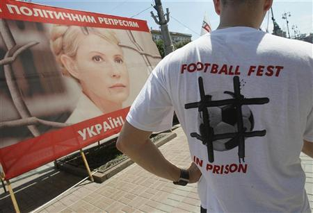 A supporter of former Ukrainian Prime Minister Yulia Tymoshenko is seen in a protest tent camp in central Kiev July 1, 2012. Ukraine kept the embarrassing case of jailed ex-premier Yulia Tymoshenko largely out of sight, the West's token protests barely registered and Ukraine, in the end, threw a smiling, trouble-free party that made it many friends among Europe's soccer-going public. REUTERS/Gleb Garanich