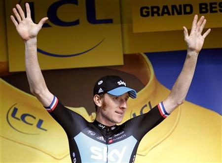 Team Sky rider Bradley Wiggins of Britain reacts on the podium after the ninth stage of the 99th Tour de France cycling race between Arc et Senans and Besancon, July 9, 2012. REUTERS/Stephane Mahe