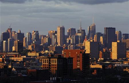 The skyline of midtown Manhattan in New York is seen at sunset behind the buildings of Jersey City, New Jersey June 3, 2012. REUTERS/Gary Hershorn