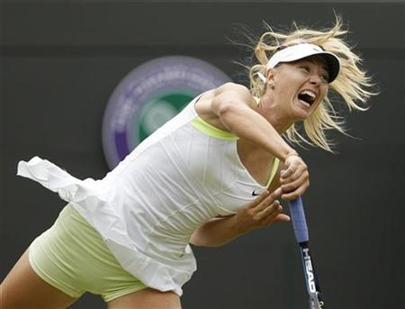 Maria Sharapova of Russia serves to Tsvetana Pironkova of Bulgaria during their women's singles tennis match at the Wimbledon tennis championships in London June 28, 2012. REUTERS/Stefan Wermuth