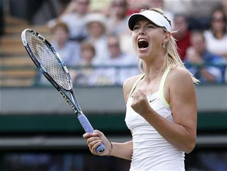 Maria Sharapova of Russia reacts to winning a point during her women's singles tennis match against Hsieh Su-Wei of Taiwan at the Wimbledon tennis championships in London June 29, 2012. REUTERS/Suzanne Plunkett