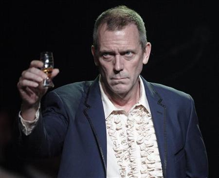 British singer and actor Hugh Laurie greets the audience before his performance at the 46th Montreux Jazz Festival in Montreux July 9, 2012. REUTERS/Denis Balibouse