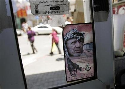 A picture depicting late Palestinian leader Yasser Arafat is seen on a door in the West Bank city of Ramallah July 4, 2012. REUTERS/Mohamad Torokman